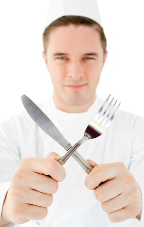 Handsome cook holding cutlery photo