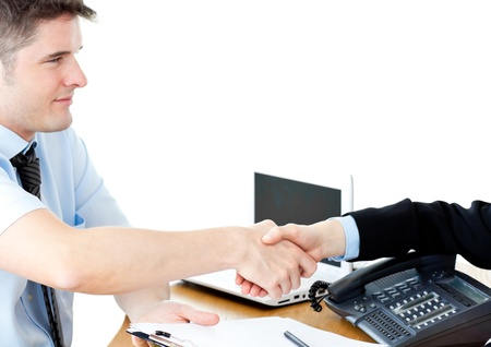 assertive: Assertive businesswoman shaking hands with a female customer  Stock Photo
