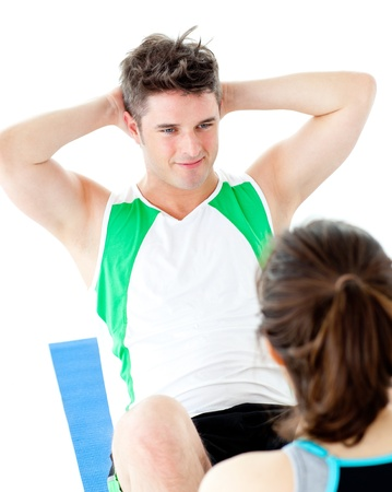 Handsome man doing fitness exercises with a woman photo