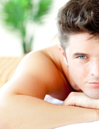 Close-up of an attractive man in a spa center  photo