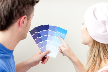 concentrated: Concentrated young couple choosing color for a room  Stock Photo