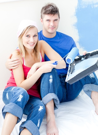 Loving couple painting a room together photo