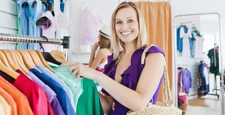 Joyful young woman choosing clothes with her friend Stock Photo - 10248670