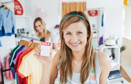alice band: Positive young woman smiling at the camera Stock Photo