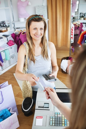 Charming young woman buying clothes with her card Stock Photo - 10249058