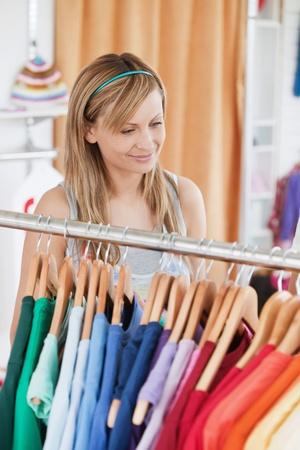 Captivating young woman choosing a colorful shirt Stock Photo - 10248969