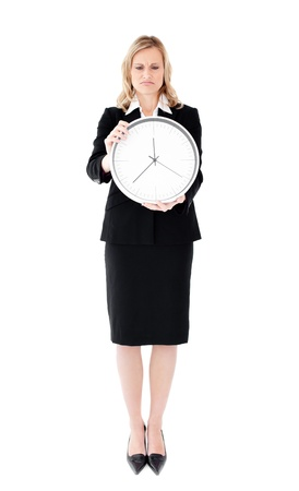 disconsolate: Frustrated businesswoman holding a clock
