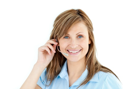 Delighted businesswoman talking on headphones  photo