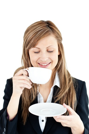 Merry businesswoman drinking a coffee  photo