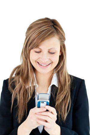 Bright blond businesswoman writing a message on her cellphone  photo