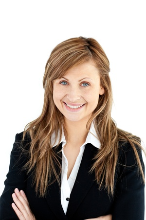 businesswoman standing: Assertive businesswoman with folded arms smiling at the camera