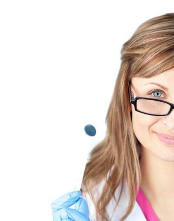 Confident female dental surgeon holding  a speculum photo