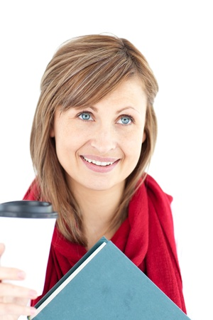 Radiant caucasian woman holding a book and coffee  photo