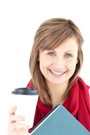 Cheerful caucasian woman holding a book and coffee  photo
