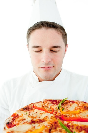Young male cook smell at pizza with closed eyes photo