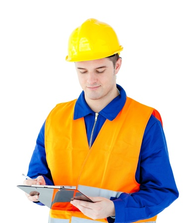 Charming young worker writing on a clipboard photo