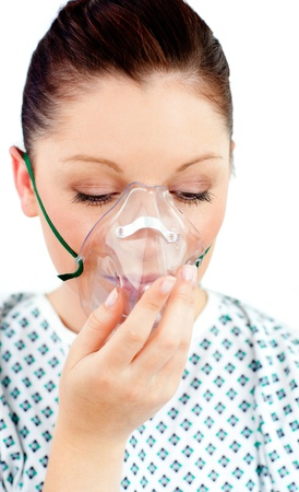 Diseased female patient wearing a oxygen mask photo