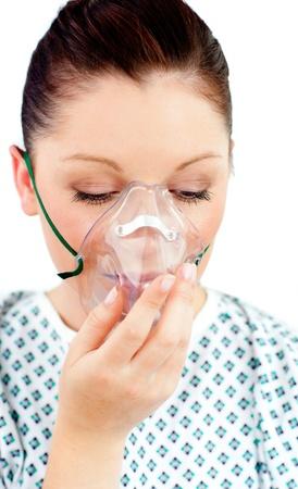 Diseased female patient wearing a oxygen mask photo