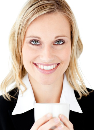 women holding cup: Radiant businesswoman holding a cup smiling at the camera
