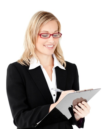 Concentrated businesswoman writing on a clipboard photo