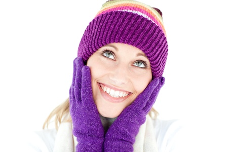 Cheerful young woman with cap and gloves in the winter  photo
