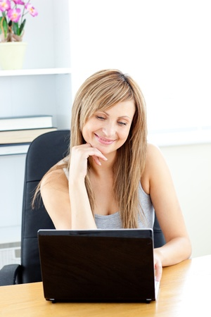 Charismatic young businesswoman using her laptop Stock Photo - 10249815