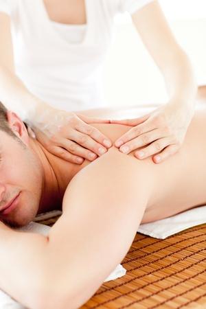 charisma: Resting man having a back massaga