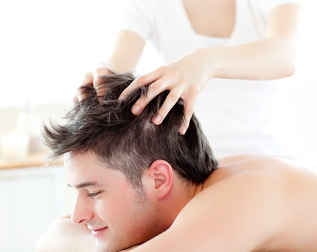adult massage: Happy young man receiving a head massage  Stock Photo