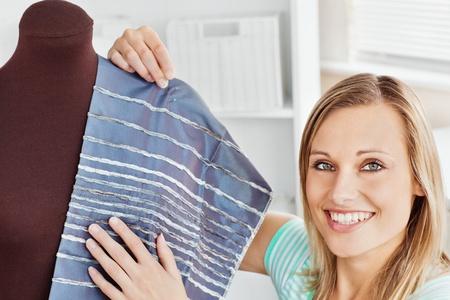 Beautfiul woman sewing at home photo