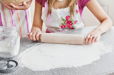Close-up of two caucasian woman baking in the kitchen  photo