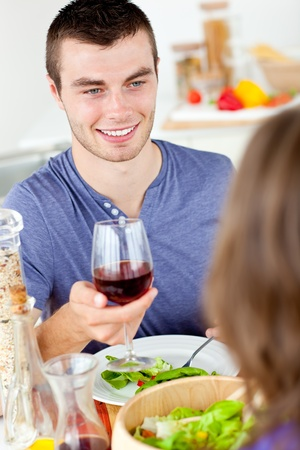 Charming young man having dinner with his girlfriend  photo