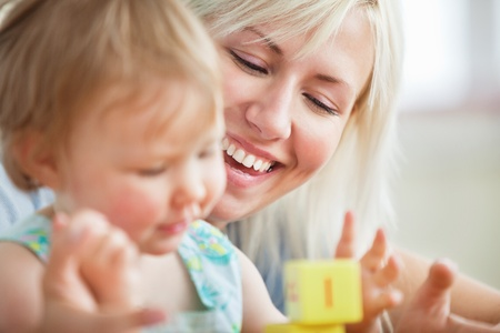 Close-up of a bright mother playing with her daughter Stock Photo - 10248825