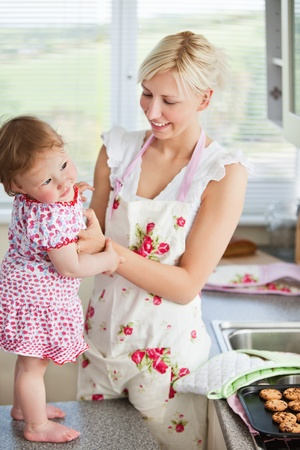 Beautiful mother baking with her daughter together  photo