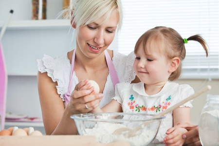 Happy mother and daughter baking together  photo