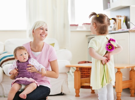Delighted mother get surprise by her daughters  Stock Photo - 10248124