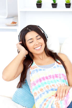 Relaxed woman listen to music wearing headphones  photo