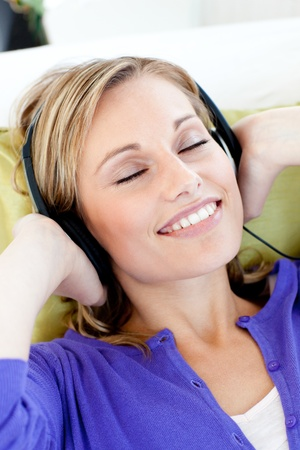 Relaxed woman listen to music with closed eyes  photo