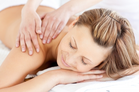 delighted: Delighted young woman having a back massage  Stock Photo