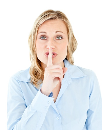 Portrait of a pretty businesswoman asking for silence  photo