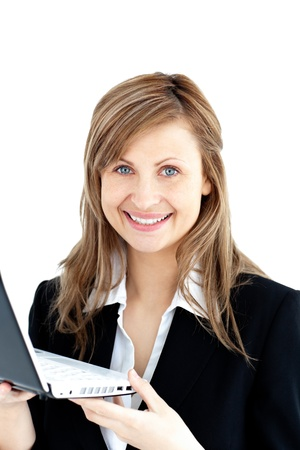 Confident businesswoman holding a laptop smiling at the camera photo