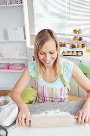 woman baking: Smiling woman baking in the kitchen