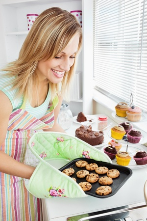 Charming woman baking in the kitchen Stock Photo - 10249003