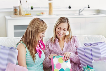 Delighted women with shopping bags  photo