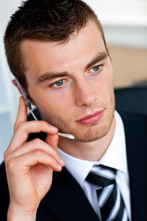 charismatic: Serious businessman wearing headset