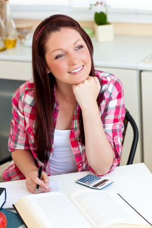 hairband: Thoughtful student doing her homework at home Stock Photo