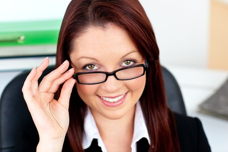 assertive: Assertive businesswoman wearing glasses