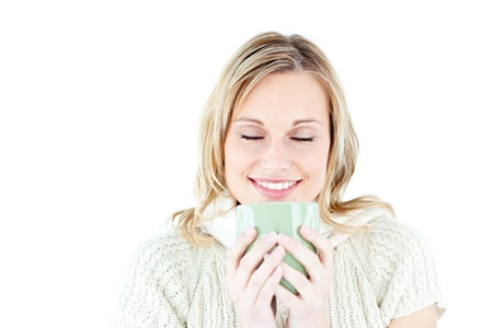 Happy woman enjoying a hot coffee photo