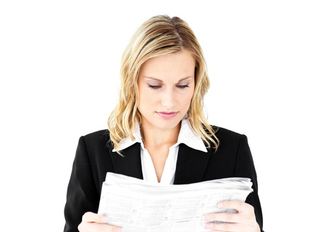 Anxious businesswoman holding a newspaper Stock Photo - 10240732