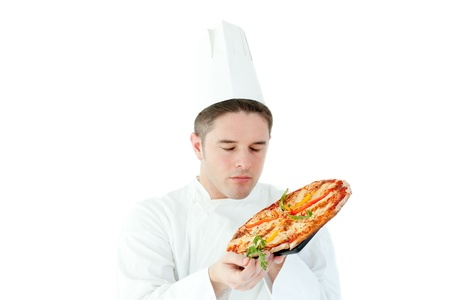 Caucasian male cook holding a pizza photo