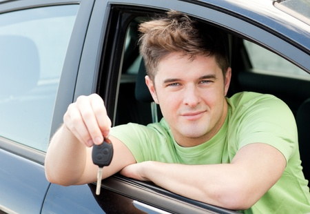 Animated caucasian man holding a car key  photo